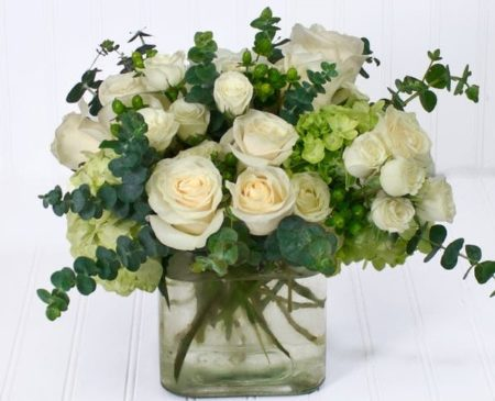 White roses nestled in beautiful hydrangea is an excellent arrangement to make anyone shine.